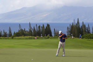 Photo - Adam Scott, of Australia, reacts to a missed birdie putt on the third green during the first round of the Tournament of Champions golf tournament, Friday, Jan. 3, 2014, in Kapalua, Hawaii. (AP Photo/Marco Garcia)