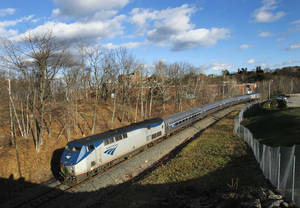 Photo -   FILE- In this Dec. 8, 2011 file photo, the Amtrak Downeaster travels through Portland, Maine. Amtrak is going to break the speed limit in the Northeast Corridor. The rail service announced Monday, Sept. 24, 2012, it will operate test trains overnight at 165 mph in four stretches from Maryland to Massachusetts. (AP Photo/Robert F. Bukaty, File)