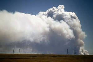 Photo -   Smoke is visible from Tie Siding, Wyo., as a wildfire burns northwest of Fort Collins, Colo., on Saturday, June 9, 2012. The cause of the fire is not yet known. (AP Photo/Laramie Daily Boomerang, Andy Carpenean)