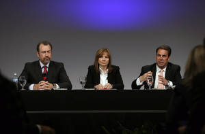 Photo -  General Motors President Dan Ammann, left, CEO Mary Barra, and Executive Vice President Mark Reuss, hold a news conference Thursday at the General Motors Technical Center in Warren, Mich.  AP Photo  <strong>Carlos Osorio -  AP </strong>