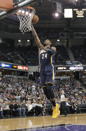 Photo - Indiana Pacers guard Paul George goes up for the breakaway layup against the Sacramento Kings during the first quarter of an NBA basketball game in Sacramento, Calif., Friday, Jan. 24, 2014. (AP Photo/Rich Pedroncelli)