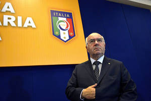 "Photo - In this picture taken Friday, July 25, 2014, Carlo Tavecchio attends an assembly of the National Amateur League in Rome. FIFA has asked the Italian football federation to open an investigation into alleged racist comments made by FIGC presidential candidate Carlo Tavecchio. ""Media reports concerning alleged racist comments by one of the presidential candidates for the Italian FA have alerted FIFA's Task Force against racism and discrimination and its chairman Jeffrey Webb,"" a statement by world football's governing body said on Monday, July 28, 2014. Amateur leagues president Tavecchio sparked outrage on Friday when he discussed the presence of foreign players in Italy. Using a hypothetical name, he said, ""In England they select players based on professionalism, whereas we say that 'Opti Poba' is here, he was eating bananas before and now he's starting for Lazio and that's OK."" (AP Photo/Daniele Leone, LaPresse)"