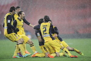 Photo - Atletico de Madrid's Raul Garcia, with shirt number eight, celebrates his goal after scoring against Athletic Bilbao, during their Spanish Copa del Rey round-8 second leg soccer match, at San Mames stadium, in Bilbao, northern Spain, Wednesday, Jan. 29, 2014. (AP Photo/Alvaro Barrientos)