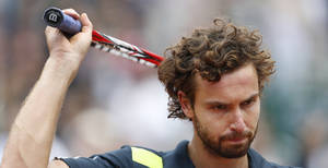 Photo - Latvia's Ernests Gulbis greets spectators after winning the fourth round match of the French Open tennis tournament against Switzerland's Roger Federer at the Roland Garros stadium, in Paris, France, Sunday, June 1, 2014. Gulbis won in five sets 6-7, 7-6, 6-2, 4-6, 6-3. (AP Photo/Darko Vojinovic)