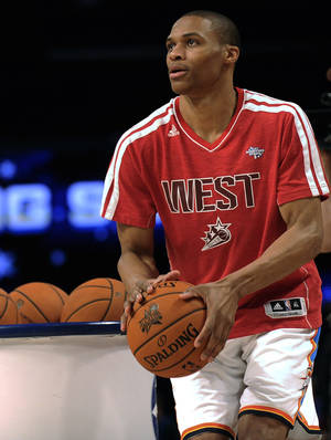 Photo - CORRECTS TO SHOOTING STARS CONTEST, NOT SKILLS CHALLENGE- Russell Westbrook of the Oklahoma City Thunder participates in the shooting stars contest during NBA All-Star Saturday Night basketball in Houston on Saturday, Feb. 16, 2013. (AP Photo/Pat Sullivan)