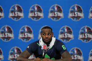 Photo - The Miami Heat's LeBron James speaks at a news conference after the NBA All Star basketball game, Sunday, Feb. 16, 2014, in New Orleans. (AP Photo/Bill Haber)