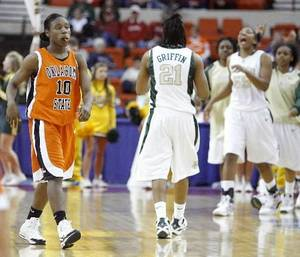 Photo - OSU's Andrea Riley walks off the court after their 67-62 loss in the  Big  12  Women's Championship game between Oklahoma State and Baylor at the Cox Center in Oklahoma City, Friday, March 13, 2009. PHOTO BY BRYAN TERRY, THE OKLAHOMAN