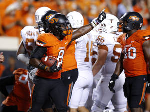 Photo - Oklahoma State's Daytawion Lowe (8) comes out with the ball after Texas' final touchdown during a college football game between Oklahoma State University (OSU) and the University of Texas (UT) at Boone Pickens Stadium in Stillwater, Okla., Saturday, Sept. 29, 2012. Oklahoma State lost 41-36. Photo by Bryan Terry, The Oklahoman