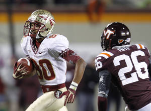 Photo -   Florida State wide receiver Rashad Greene (80) heads to the end zone in front of Virginia Tech safety Desmond Frye (26) for the go-ahead touchdown during the second half of an NCAA college football game in Blacksburg, Va., Thursday, Nov. 8, 2012. Florida State won the game 28-22. (AP Photo/Steve Helber)