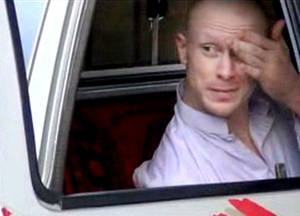 Photo - In this image taken from video obtained from Voice Of Jihad Website, which has been authenticated based on its contents and other AP reporting, Sgt. Bowe Bergdahl, sits in a vehicle guarded by the Taliban in eastern Afghanistan. A U.S. defense official says released captive Army Sgt. Bowe Bergdahl is scheduled to arrive at a military medical center in Texas on Friday. The official, who spoke Thursday on condition of anonymity because the plan has not been publicly announced, declined to provide details. Officials had previously said the intention was for Bergdahl to be reunited with his family at Brooke Army Medical Center in San Antonio. (AP Photo/Voice Of Jihad Website via AP video)