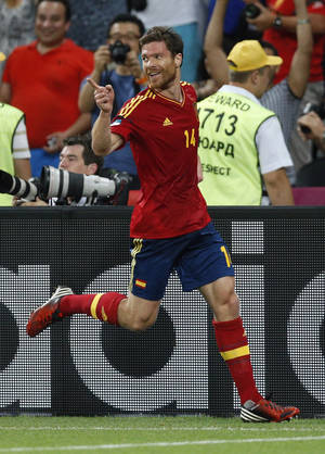 Photo -   Spain's Xabi Alonso celebrates scoring the opening goal during the Euro 2012 soccer championship quarterfinal match between Spain and France in Donetsk, Ukraine, Saturday, June 23, 2012. (AP Photo/Michael Sohn)