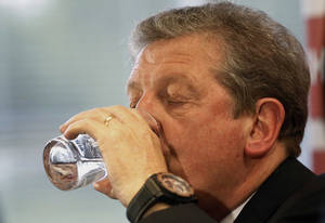 Photo - England's soccer manager Roy Hodgson, takes a sip of water during the press conference announcing the squad for the World Cup in Brazil at Vauxhall headquarters,  in Luton, England, Monday, May 12, 2014.  England coach Roy Hodgson selected a World Cup squad containing several young players on Monday, although Frank Lampard was among the veterans to still make the cut. (AP Photo/Sang Tan)