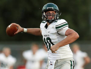 Photo - Norman North's David Cornwell (10) passes against Edmond Santa Fe during a football scrimmage at Edmond Santa Fe High School in Edmond, Okla., Thursday, Aug. 22, 2013. Photo by Nate Billings, The Oklahoman