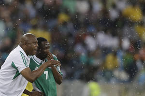 Photo - FILE - In this Feb. 6, 2013, file photo, Nigeria's head coach Stephen Keshi, left, talks to player Ahmed Musa, after Musa scored a goal during their African Cup of Nations semifinal soccer match against Mali, at Moses Mabhida Stadium in Durban, South Africa. After impressing on their way to the second round in each of their first two FIFA World Cup appearances, 1994 and 1998, Nigeria have struggled since: going out at the group stage three times while taking just two points from their last eight matches in the finals. (AP Photo/Rebecca Blackwell, File)