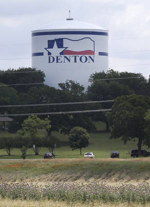 Photo -  A water tank is adorned with a Texas flag and city theme in Denton.   AP Photos  <strong>LM Otero -  AP </strong>