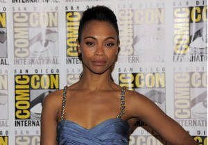 """Photo - Zoe Saldana arrives at the """"Guardians of the Galaxy"""" panel  on Day 4 of Comic-Con International, Saturday, July 20, 2013, in San Diego. (Photo by Chris Pizzello/Invision/AP)"""