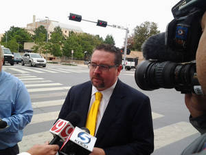 photo - Defense attorney Scott Adams talks to the media Thursday after a federal judge ruled he can stay in an illegal gambling case. Photo by Nolan Clay, The Oklahoman