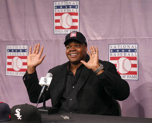 Photo - Chicago White Sox slugger Frank Thomas smiles as he responds to a question during a news conference about his selection into the MLB Baseball Hall Of Fame Wednesday, Jan. 8, 2014, at U.S. Cellular Field in Chicago. Thomas joins Greg Maddux and Tom Glavine as first ballot inductees Wednesday, and will be inducted in Cooperstown on July 27 along with managers Bobby Cox, Joe Torre and Tony La Russa, elected last month by the expansion-era committee. (AP Photo/Charles Rex Arbogast)