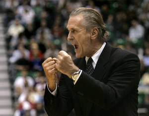 Photo - Miami Heat head coach Pat Riley yells at a referee during the first quarter of the Utah Jazz NBA basketball game Monday, Dec. 3, 2007, in Salt Lake City. (AP Photo/Douglas C. Pizac) ORG XMIT: SLCJ105