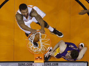 Photo - Phoenix Suns forward Markieff Morris dunks against Los Angeles Lakers forward Ryan Kelly during an NBA basketball game Wednesday, Jan. 15, 2014, in Phoenix. (AP Photo/The Arizona Republic, Michael Chow) MESA OUT  MARICOPA COUNTY OUT  MAGS OUT