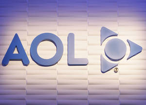 Photo - The AOL logo is seen at the AOL booth at a consumer electronics show in Las Vegas.  AP Photo