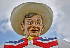 Photo - The newly rebuild Big Tex at the Texas State Fair on Friday, Oct. 11, 2013 in Dallas, Texas. The statue has to be rebuilt after catching fire last year.  Photo by Chris Landsberger, The Oklahoman