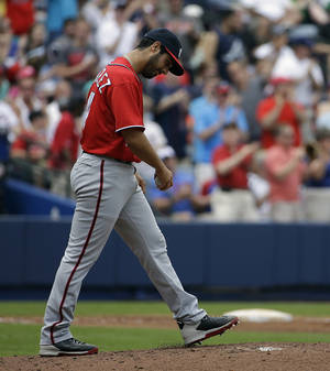 Photo - Washington Nationals starting pitcher Gio Gonzalez walks back to the mound after giving up a two-run home run to Atlanta Braves' Freddie Freeman in the second inning of a baseball game, Sunday, April 13, 2014, in Atlanta. (AP Photo/David Goldman)