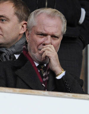 "Photo -   FILE This Saturday, Jan. 8, 2011 file photo shows West Ham United co-chairman David Gold waiting for the start of their third round English FA Cup soccer match against Barnsley at the Upton Park stadium, London. In August of 1944, when the tough east London streets of his childhood lay smoking in bombed-out ruins, a Nazi German V1 rocket packed with one ton of high explosives ""fell just where you're sitting,"" David Gold says coolly. He is simply making a point: This part of London has long had more than its share of foul luck; it was high time that changed; and the 2012 Olympic Games are helping do that, by focusing the world's eyes on what used to be a derelict, polluted patch of industrial land near Gold's childhood home but which now is a shining advertisement for east London: the immaculate, landscaped Olympic Park with purpose-built sports venues which smell like a new car. So damn the expense.(AP Photo/Tom Hevezi)"