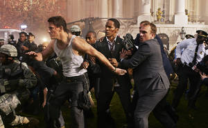 "Photo - Channing Tatum, left, and Jamie Foxx, center, in a scene from ""White House Down,"" directed by Roland Emmerich. SONY PICTURES ENTERTAINMENT <strong>Reiner Bajo</strong>"
