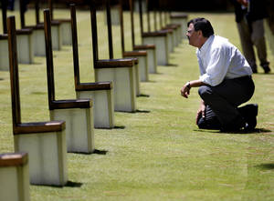 Photo - Lt. Gov. Matt Michels, of South Dakota, looks at the chairs July 18 during at tour of the Oklahoma City National Memorial & Museum. <strong>SARAH PHIPPS</strong>