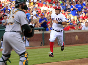 Photo -   Texas Rangers' Ian Kinsler (5) heads home to score on Elvis Andrus' hit during the third inning of a baseball game against the Oakland Athletics, Sunday, July 1, 2012, in Arlington, Texas. (AP Photo/John F. Rhodes)