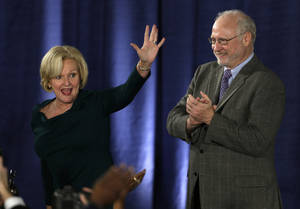 Photo -   Sen. Claire McCaskill, D-Mo., waves to supporters alongside her husband, Joseph Shepard, right, after declaring victory over challenger Rep. Todd Akin, R-Mo., in the Missouri Senate race Tuesday, Nov. 6, 2012, in St. Louis. (AP Photo/Jeff Roberson)