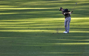 Photo - Danny Lee, of New Zealand, hits along the fifth fairway during the first round of the Valspar Championship golf tournament at Innisbrook Thursday, March 13, 2014, in Palm Harbor, Fla. (AP Photo/Chris O'Meara)