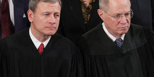 Photo - WASHINGTON, DC - JANUARY 28:  U.S. Supreme Court Chief Justice John Roberts (L) and Associate Justice Anthony Kennedy listen to President Barack Obama deliver the State of the Union address to a joint session of Congress in the House Chamber at the U.S. Capitol on January 28, 2014 in Washington, DC. In his fifth State of the Union address, Obama is expected to emphasize on healthcare, economic fairness and new initiatives designed to stimulate the U.S. economy with bipartisan cooperation.  (Photo by Chip Somodevilla/Getty Images)