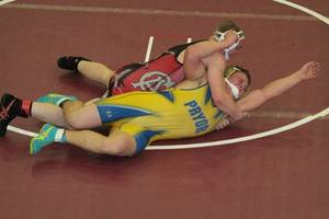 Photo - Carl Albert's Kyle Croak, top, wrestles Pryor's Jake Gibson at the Class 5A East Wrestling Regionals. PHOTO PROVIDED