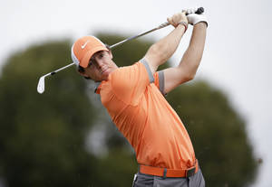 Photo - Rory McIlroy of Northern Ireland tees off on the fifth hole during the first round of the Honda Classic golf tournament, Thursday, Feb. 27, 2014, in Palm Beach Gardens, Fla. (AP Photo/Lynne Sladky)