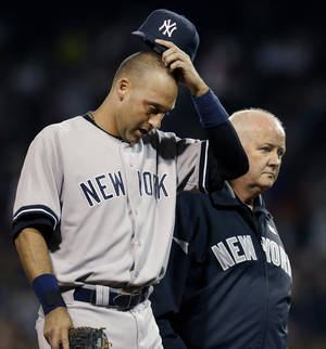 Photo -   New York Yankees' Derek Jeter leaves the game with team trainer Steve Donohue after he was injured trying to beat out a grounder during the eighth inning of a baseball game against the Boston Red Sox at Fenway Park in Boston Wednesday, Sept. 12, 2012. (AP Photo/Elise Amendola)