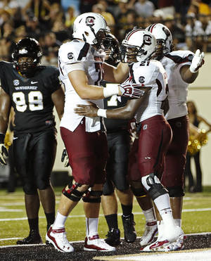 Photo -   South Carolina's Marcus Lattimore (21) celebrates his game-winning touchdown with teammates in the second half of an NCAA college football game, Thursday, Aug. 30, 2012, in Nashville, Tenn. South Carolina won 17-13. (AP Photo/John Russell)