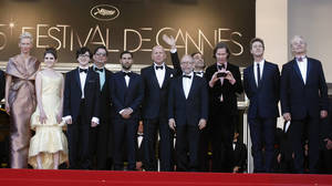 Photo -   From left actors, Tilda Swinton, Kara Hayward, Jared Gilman, screenwriter Roman Coppola, actors Jason Schwartzman, Bruce Willis, Bob Balaban, composer Alexandre Desplat, director Wes Anderson, actors Edward Norton and Bill Murray arrive for the opening ceremony and screening of Moonrise Kingdom at the 65th international film festival, in Cannes, southern France, Wednesday, May 16, 2012. (AP Photo/Lionel Cironneau)