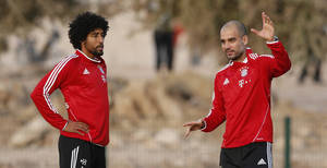Photo - Bayern head coach Pep Guardiola of Spain, right, talks to Dante of Brazil during a training session at the Club World Cup soccer tournament in Agadir, Morocco, Sunday, Dec. 15, 2013. Bayern Munich will face Guangzhou Evergrande in the first semi final on Tuesday, Dec 17. (AP Photo/Matthias Schrader)