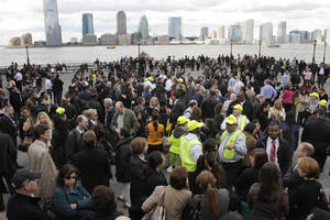 Photo -   Office workers stand outside Two World Financial Center after it was briefly evacuated in New York, Thursday, April 12, 2012. Authorities say an evacuation was ordered as a precaution at a World Financial Center building after a security guard reported a package that seemed suspicious. (AP Photo/Seth Wenig)