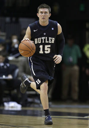 photo - Butler guard Rotnei Clarke brings the ball upcourt against Vanderbilt in the second half of an NCAA college basketball game on Saturday, Dec. 29, 2012, in Nashville, Tenn. Clarke led his team with 22 points as Butler won 68-49. (AP Photo/Mark Humphrey) ORG XMIT: TNMH113