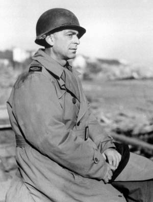 Photo -   In this March 1, 1944 file photo, Ed Kennedy, Chief of the Associated Press staff in North Africa, wears a metal helmet at the Anzio beachhead in Italy. Kennedy was dismissed by The AP after he became the first journalist to file a firsthand account of German officials surrendering unconditionally to Allied commanders at a former schoolhouse in Reims, France. Sixty-seven years later, AP President and Chief Executive Officer Tom Curley said that Kennedy was right to stand up to the censors, and should have been commended, not fired. (AP Photo, Pool)