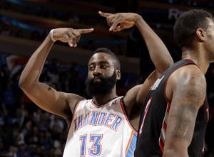 Photo - CELEBRATION: Oklahoma City's James Harden (13) celebrates a three-pointer during the NBA basketball game between the Oklahoma City Thunder and the Toronto Raptors at Chesapeake Energy Arena in Oklahoma City, Sunday, April 8, 2012. Photo by Sarah Phipps, The Oklahoman.