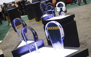 Photo - New headphone models produced by Stillwater-based Kicker are displayed Wednesday at the 2013 International CES consumer electronics show in Las Vegas.  Photo by PAUL RIEDL,  For The Oklahoman