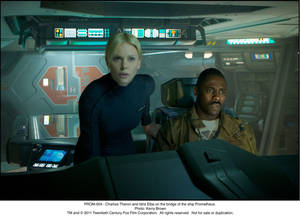 Photo - PROM-004 - Charlize Theron and Idris Elba on the bridge of the ship Prometheus.
