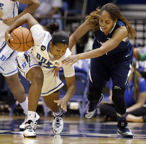 Photo - Duke's Ka'lia Johnson, left,  grabs the loose ball before Old Dominion's Shae Kelley can do it during the first half of an NCAA college basketball game in Durham, N.C., Thursday, Jan. 2, 2014. (AP Photo/Gerry Broome)