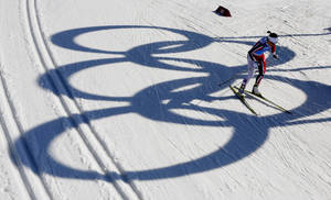 Photo - Norway's Marit Bjoergen skis past the Olympic rings during the women's 4x5K cross-country relay at the 2014 Winter Olympics, Saturday, Feb. 15, 2014, in Krasnaya Polyana, Russia. (AP Photo/Dmitry Lovetsky)