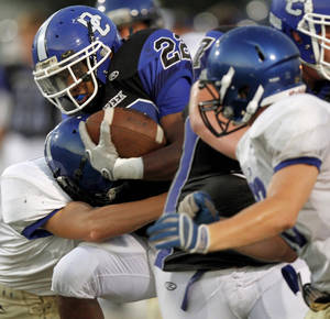 Photo - Deer Creek's Marcus Coleman is brought down during a high school football scrimmage in Norman, Okla., Friday, August 26, 2011. Photo by Bryan Terry, The Oklahoman ORG XMIT: KOD