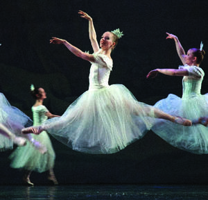 "Photo - Dancer Mary Lyn Graves is caught mid air in this scene from the Oklahoma Festival Ballet's ""The Nutcracker.""   Photo provided  <strong>Photo provided</strong>"